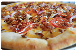 Signature red buffalo base pizza topped with mozzarella and cheddar                  cheeses, bacon, chicken, tomatoes and red onion.