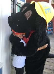 Jake hugging a young salty dog guest
